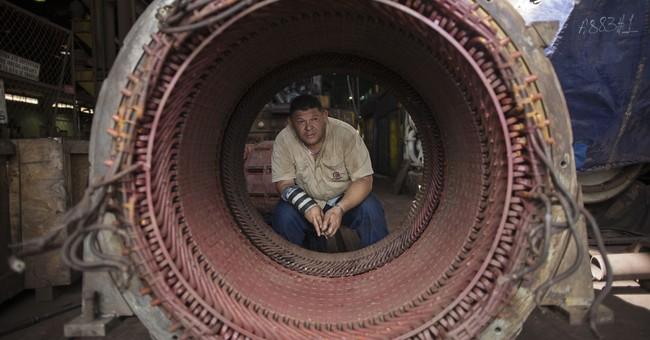Crisis-wracked Venezuela turns for hope to broken factories