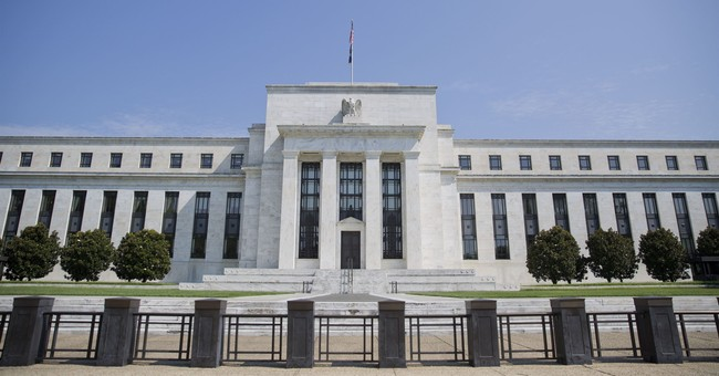 Fed officials expect economic boost from tax cuts