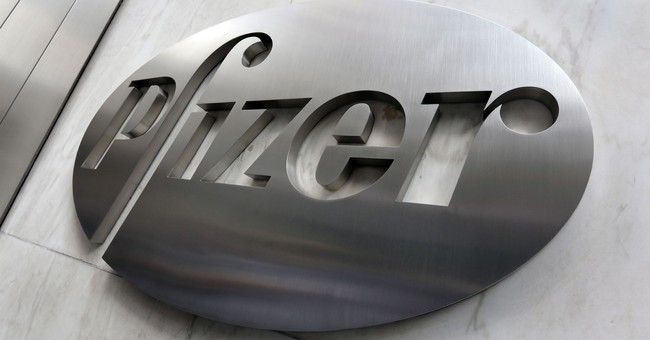 Pfizer, riding tax changes, puts up huge 4Q profit
