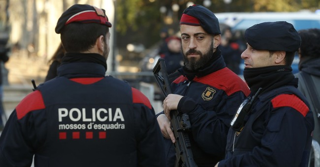 The Latest: Spain welcomes postponing Catalonia vote