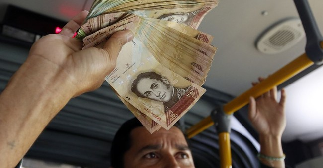Venezuela drops overvalued exchange rate for state imports