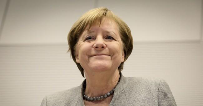 German coalition talks break impasse on migrants' relatives