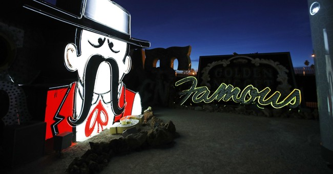 Historic Vegas neon signs shine bright for 1st time in years