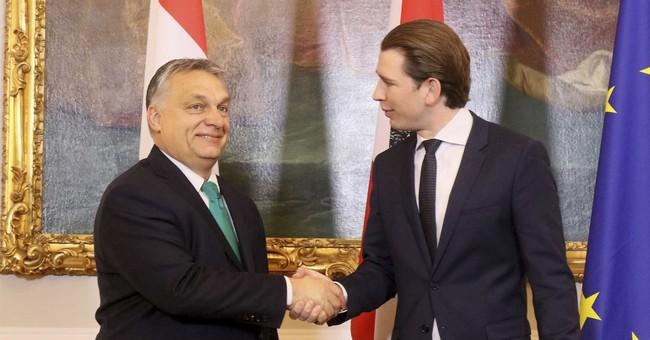 Austria chancellor backs Visegrad nations on migrant quotas