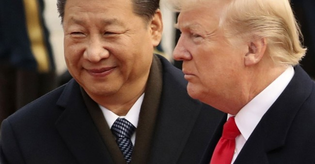 The Latest Trump says he'll meet China's Xi at G-20 meeting