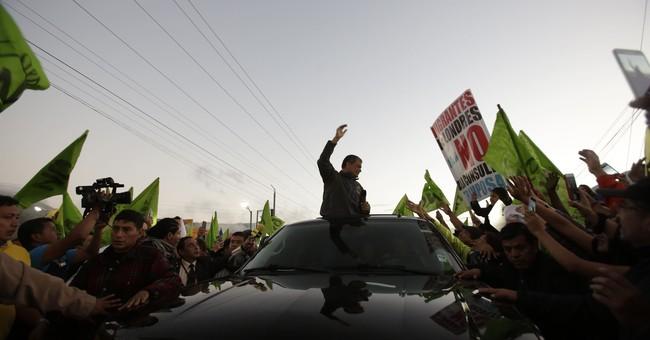 Protesters hurl trash on Ecuador ex-president's vehicle