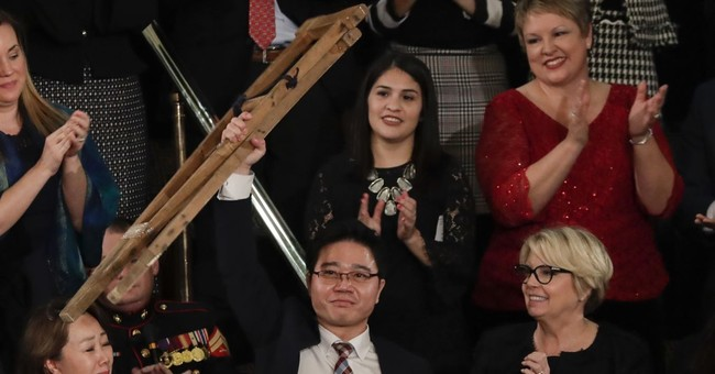 Crutches, tears humanize North Korean threat in Trump speech