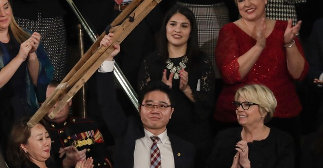 Crutches, tears humanize North Korean threat in Trump speech