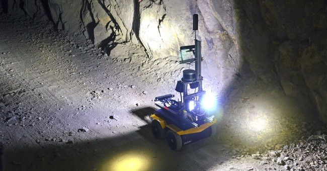 US officials consider new tool to combat mine spills: Robots