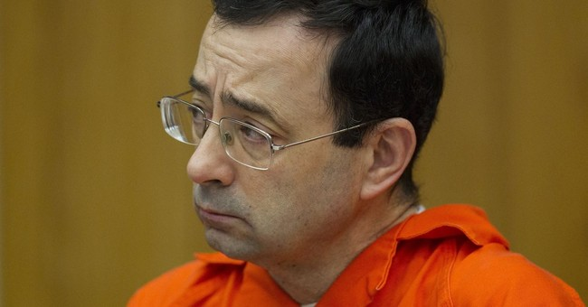 The Latest: Dad who lunged at Nassar says he's 'no hero'