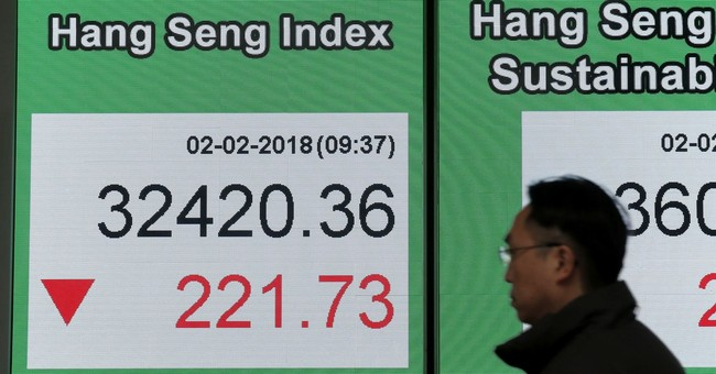 Asian shares lower as investors mull earnings, yields weigh