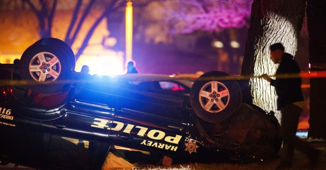Authorities: Man shot trying to flee crash in police vehicle