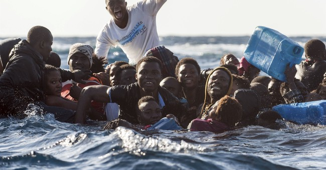 EU says asylum numbers dropped by almost half in 2017