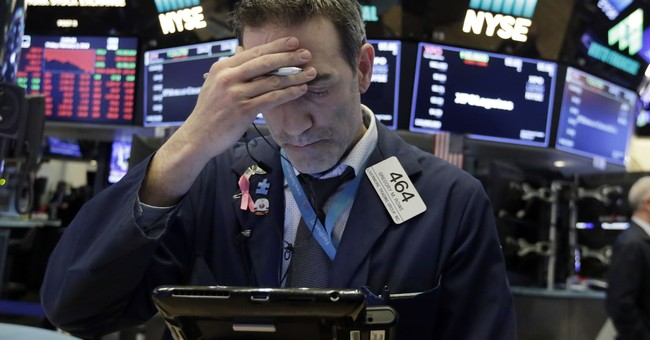US stocks swoon, sending Dow down more than 650 points