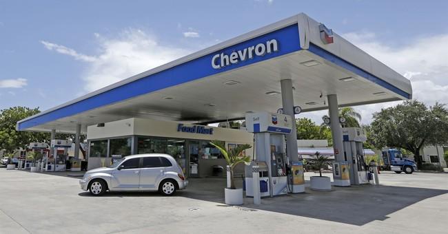 Exxon, Chevron report sharply higher 4Q profit on tax gains