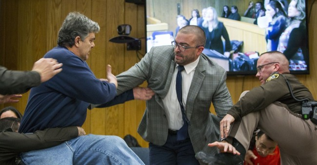 Victims' dad apologizes after lunging at Nassar in courtroom