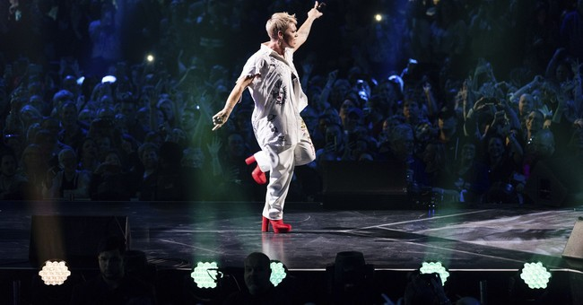 With the flu, Pink powers through pre-Super Bowl concert