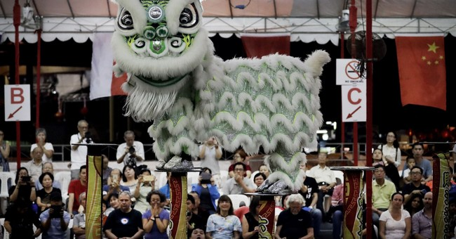 AP PHOTOS: Lion dance in Singapore ahead of Lunar New Year