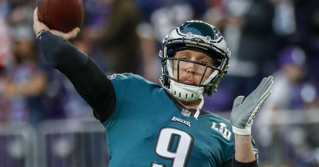 AP PHOTOS: Eagles beat Patriots in a thrilling Super Bowl