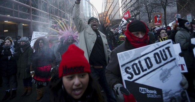 Protesters block trains near Super Bowl, march on stadium