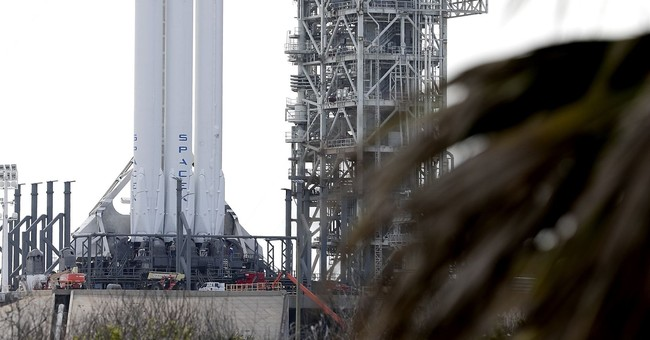 The Latest: SpaceX launches big new rocket; lands 2 boosters