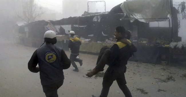 The Latest: UN official calls for 30-day Syria cease-fire