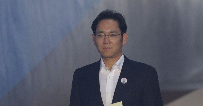 Samsung heir freed after appeal wins suspended jail term