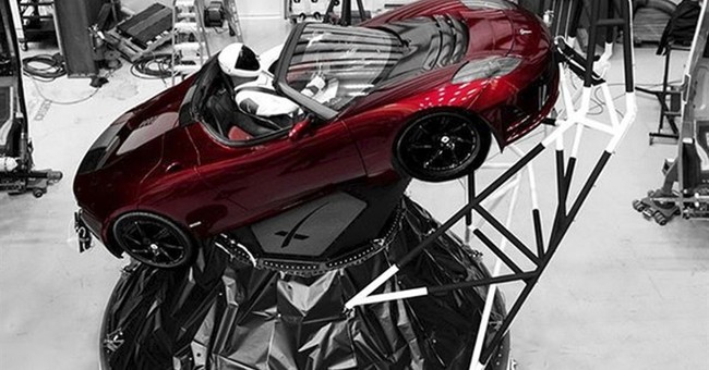 SpaceX 'Starman' at wheel of sports car flying on new rocket