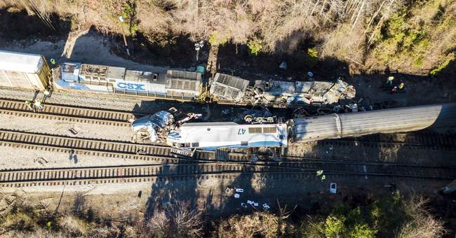 The Latest: Passengers recount smoke, blood on crashed train