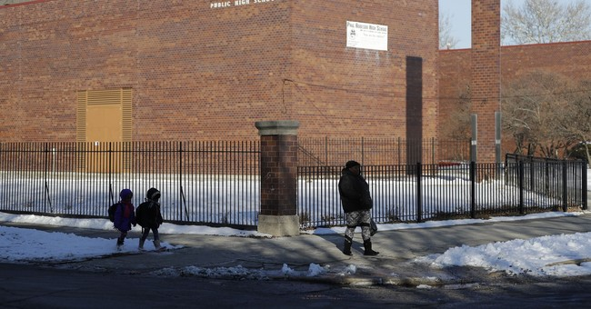 After closing record schools, Chicago's new plan draws fury