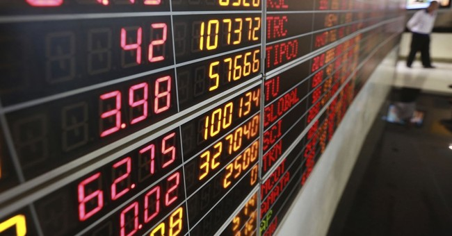 Markets Right Now: Asian shares tumble, Nikkei drops 7.1 pct