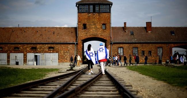 The Latest: Yad Vashem fears Polish law may distort history