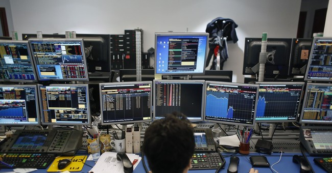 AP PHOTOS: Another wild ride for global stock markets