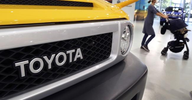 Toyota lifts profit forecast to record 2.4 trillion yen