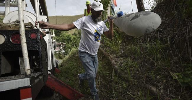 Puerto Ricans grab machetes, shovels to help restore power