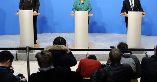 Merkel clinches German coalition govt deal, hurdle remains