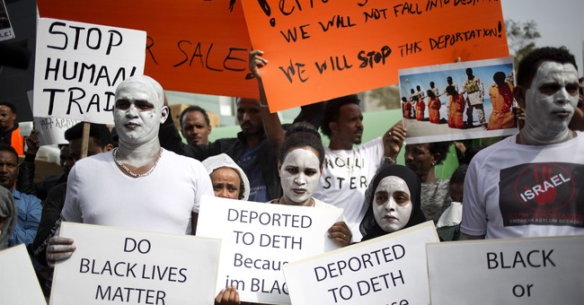 Thousands of African migrants protest Israel deportations