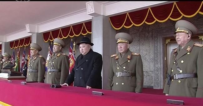 With military parade, Kim Jong Un thumbs nose at US