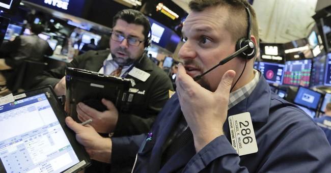 Markets Right Now: China share benchmark falls 5.5 percent