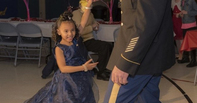 National guardsman takes girl whose dad was killed to dance