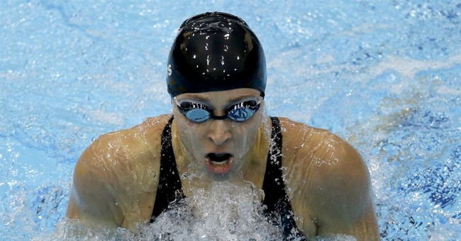 The Latest: Olympic swimmer pens essay describing abuse