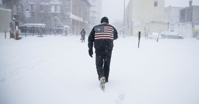 Blizzard rolls up the East Coast, with cold blast to follow