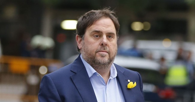 The Latest: Ex-Catalan VP says he will obey law if released