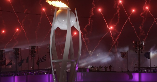 At Olympics, fiery optics both entertaining and symbolic