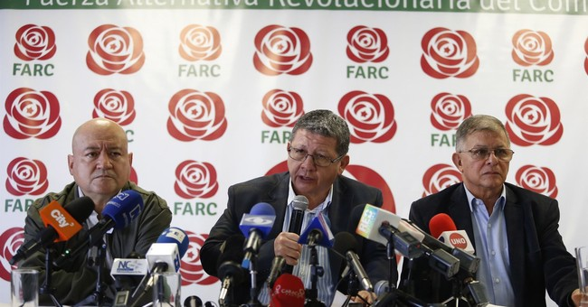 Ex-guerillas suspend political campaigns in Colombia