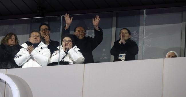The Latest: Spotlight on united Koreas in ceremony, on ice