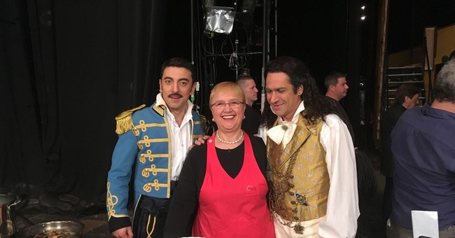 Tasty role: Bass gets pasta on stage from celebrity chef