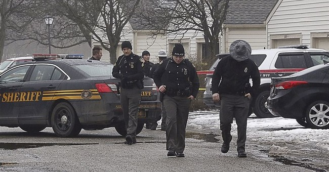 The Latest: Police identify suspect in 2 officers' shootings
