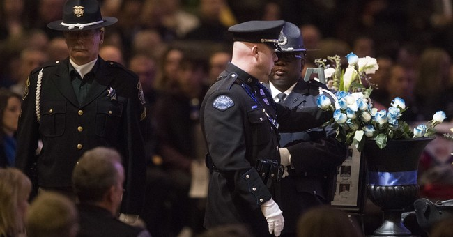 Slain deputy remembered as a 'great hero' at funeral