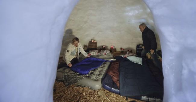 Igloos built by migrants warm hearts in Italian Alps village